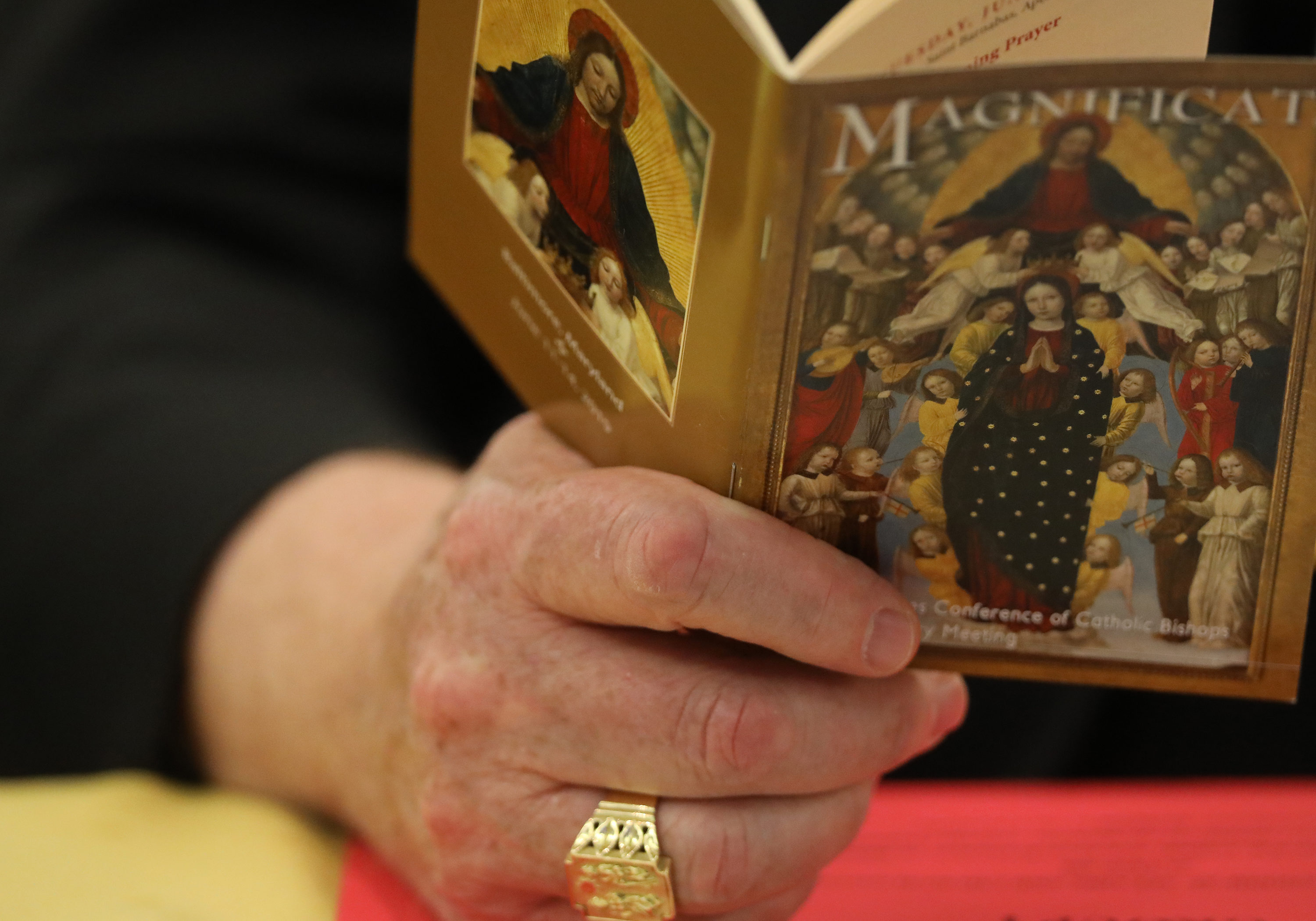 The ring of Cardinal Joseph W. Tobin of Newark, N.J., is seen during morning prayer at the spring general assembly of the U.S. Conference of Catholic Bishops in Baltimore June 13, 2019. (CNS photo/Bob Roller) See stories marked BISHOPS- June 13, 2019.