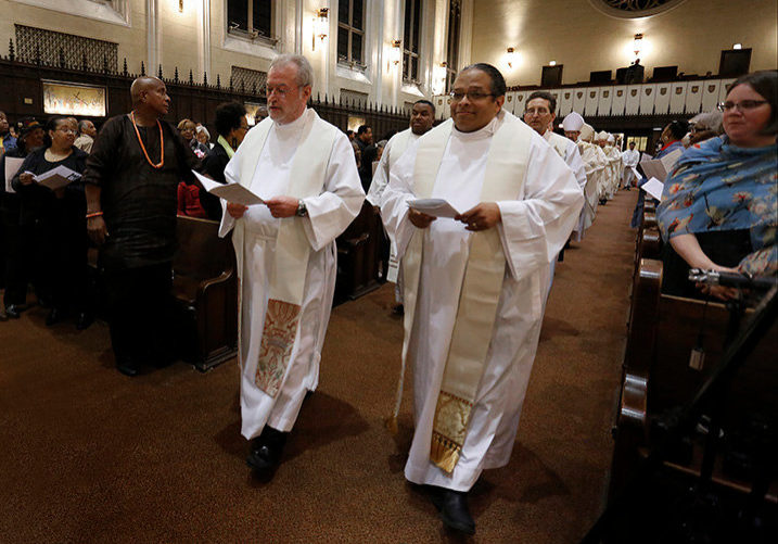 """Father Michael Penn, pastor of Holy Rosary parish in Monroe City, Missouri and Norbertine Gerard Jordan, who is helping Auxiliary Bishop Joseph N. Perry advocate on behalf of Tolton's canonization, walk in the entrance procession. Cardinal Cupich was the main celebrant at a Mass of Thanksgiving honoring Venerable Rev. Augustus Tolton on Oct. 14, 2019 at St. Philip Neri Church, 2132 E. 72nd St., Chicago. The Mass celebrated Pope Francis' June 11, 2019 declaration of Tolton as """"Venerable."""" He is the first African American priest to receive this designation, a step toward possible sainthood. (Karen Callaway/Chicago Catholic)"""